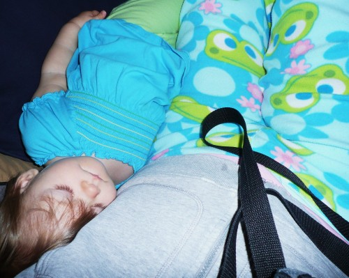 napping baby and mom with froggy pants