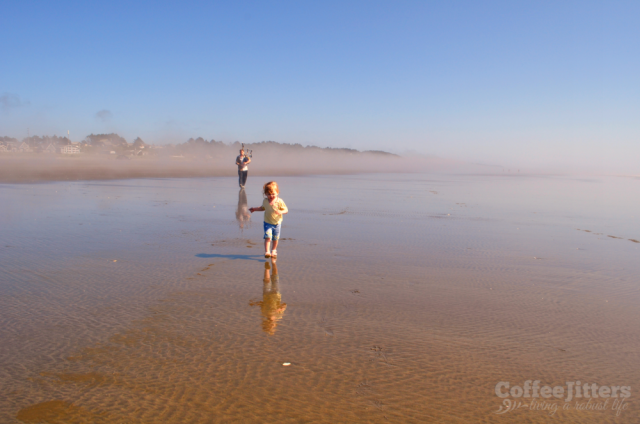 baby and bagpiper on the beach